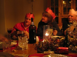 Uncle Johnny, Mum, and Uncle Peter celebrate the Ecksmas tradition of paper crowns and bad jokes.
